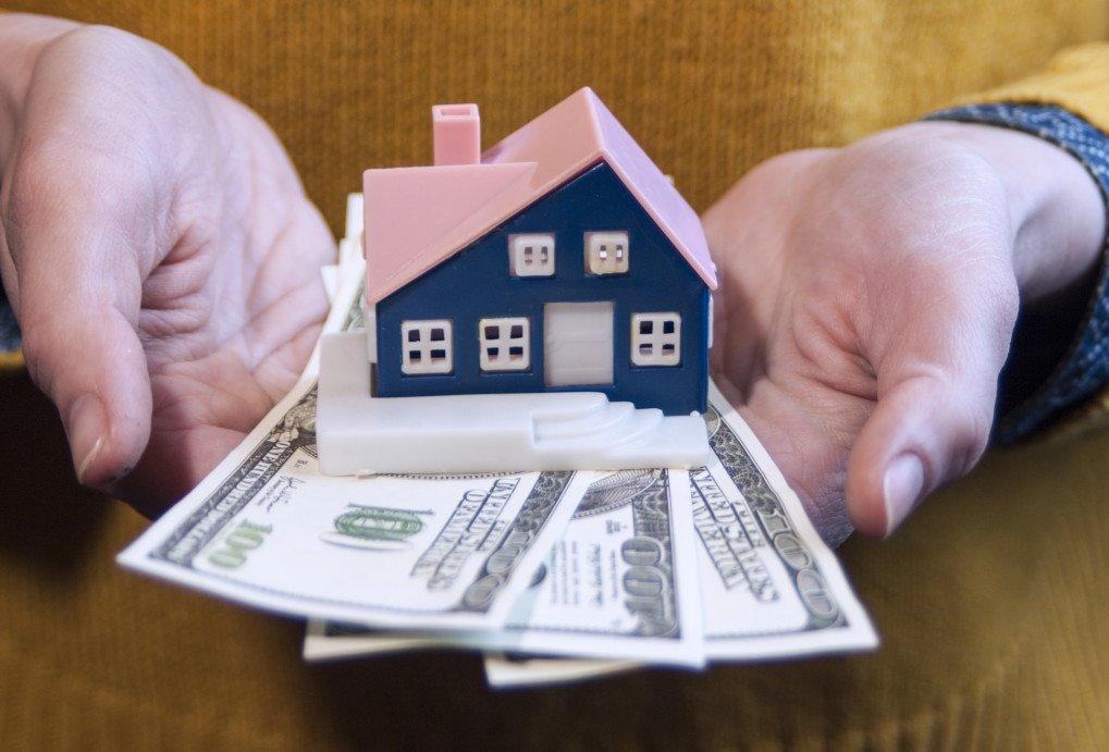 Amsterdamse woningen leveren minder op voor beleggers